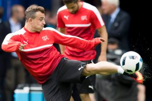 epa05364394 Swiss soccer player Xherdan Shaqiri in action during a training session, at the Parc des Princes stadium, in Paris, France, Tuesday, June 14, 2016. The Swiss national soccer team will play Romania in Group A on 15 June during the UEFA EURO 2016 soccer championship in France. (RESTRICTIONS APPLY: For editorial news reporting purposes only. Not used for commercial or marketing purposes without prior written approval of UEFA. Images must appear as still images and must not emulate match action video footage. Photographs published in online publications (whether via the Internet or otherwise) shall have an interval of at least 20 seconds between the posting.) EPA/JEAN-CHRISTOPHE BOTT EDITORIAL USE ONLY